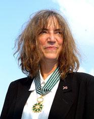 """Remise des insignes de Commandeur dans l'Ordre des Arts et des Lettres à Patti Smith """" Solidays """""""
